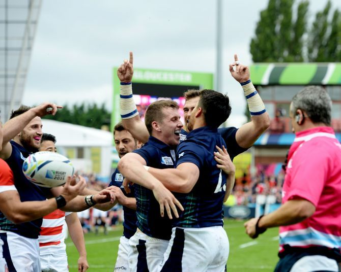 Scotland's Mark Bennett (left) celebrates his try with team-mates.