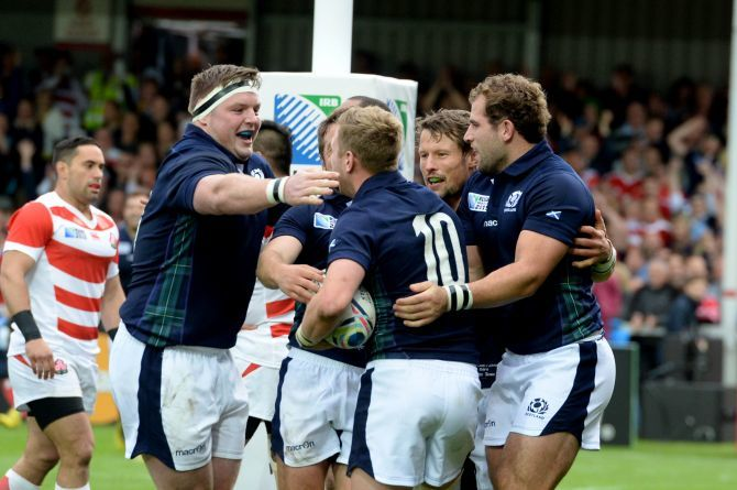 Scotland's Jon Welsh (left) celebrates with try scorer Finn Russell.