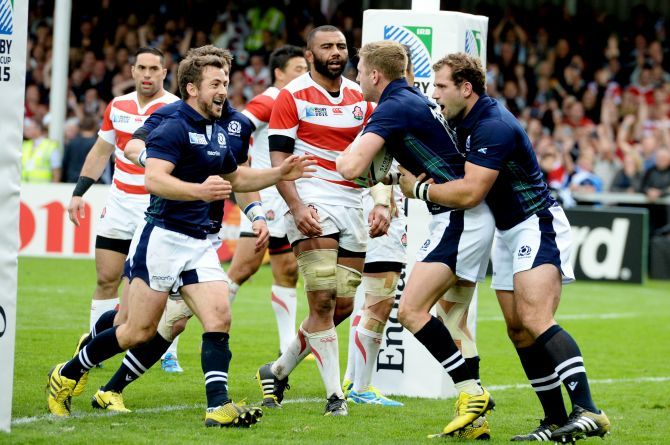 Scotland's Greig Laidlaw (left) celebrates with try scorer Finn Russell.