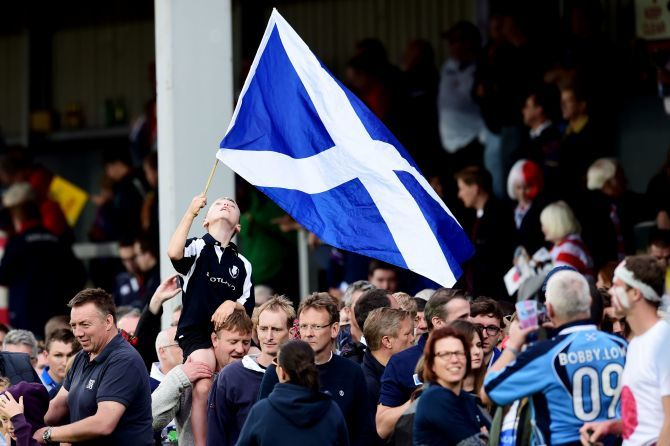 A young Scotland fan celebrates the national side's win.