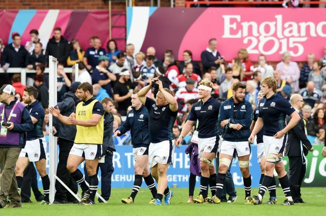 Scotland players celebrate their win over Japan.