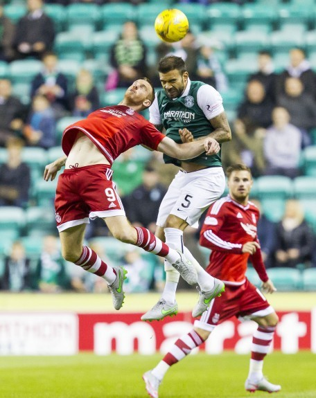 Aberdeen's Adam Rooney (left) battles with Liam Fontaine