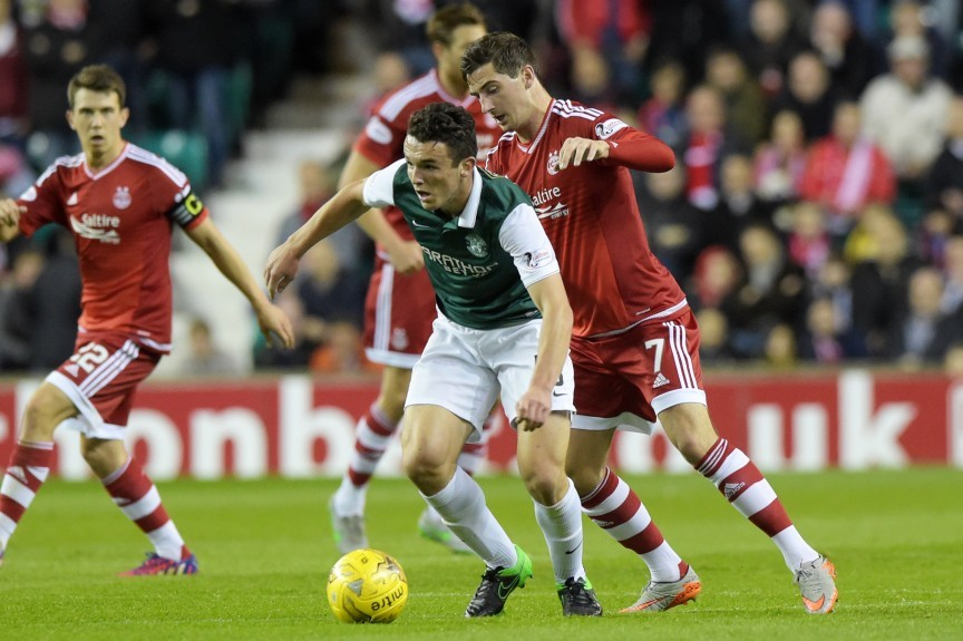 Hibernian's John McGinn (front) is closed down by Kenny McLean