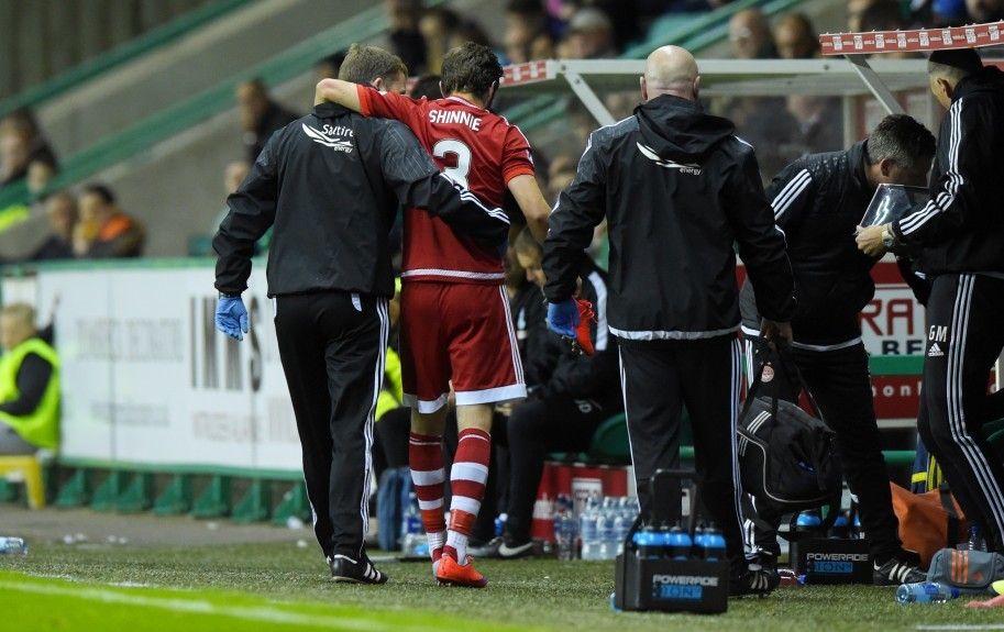 Aberdeen's Graeme Shinnie is helped off the park after picking up an injury