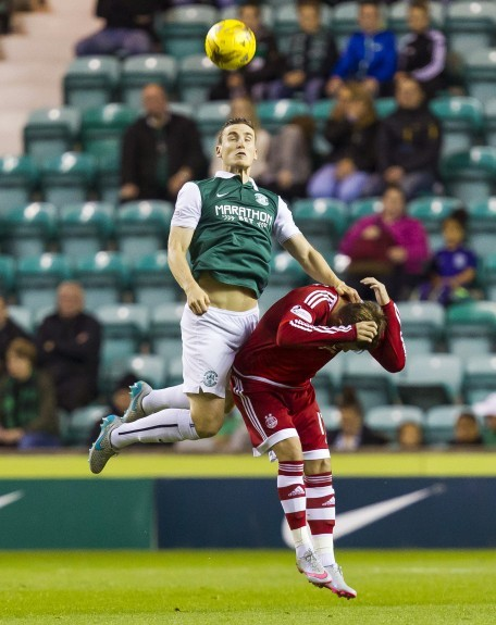 Hibernian's Paul Hanlon (left) beats David Goodwillie in the air