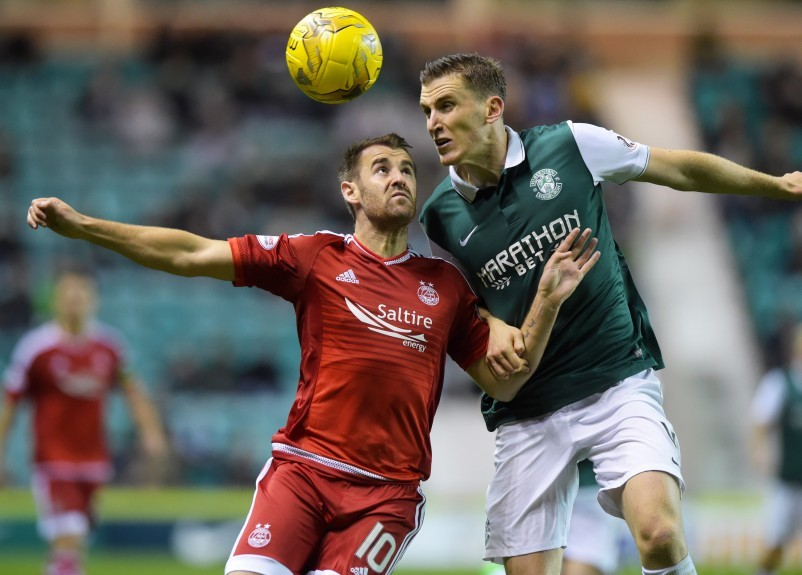 Aberdeen's Niall McGinn (left) tussles with Paul Hanlon