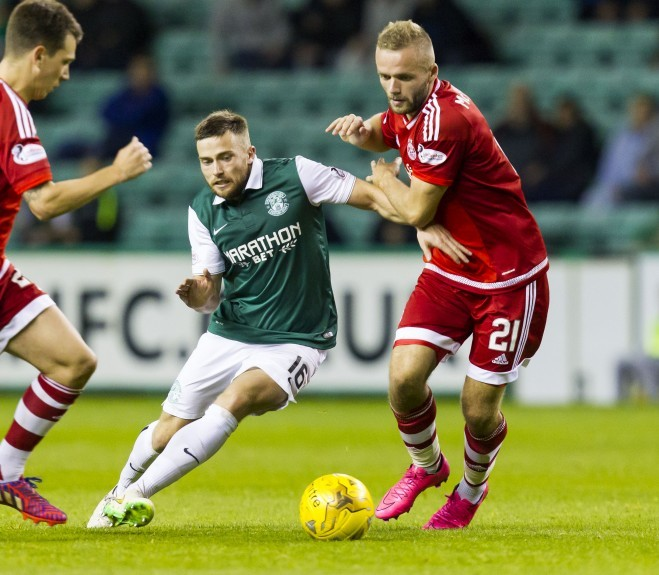Hibernian's Lewis Stevenson (left) battles with Ryan McLaughlin