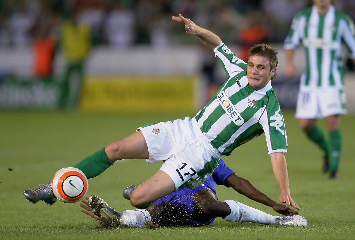 Joaquin of Betis is tackled by Claude Makelele of Chelsea.