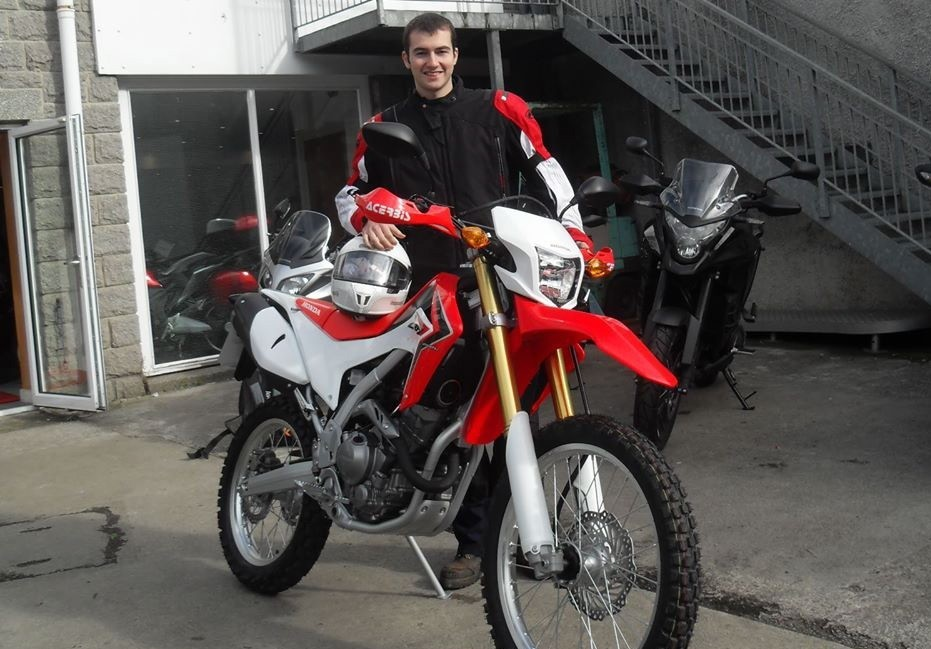 Michael McLaggan with his  prized Honda CRF250 motorbike which was stolen from his back garden.