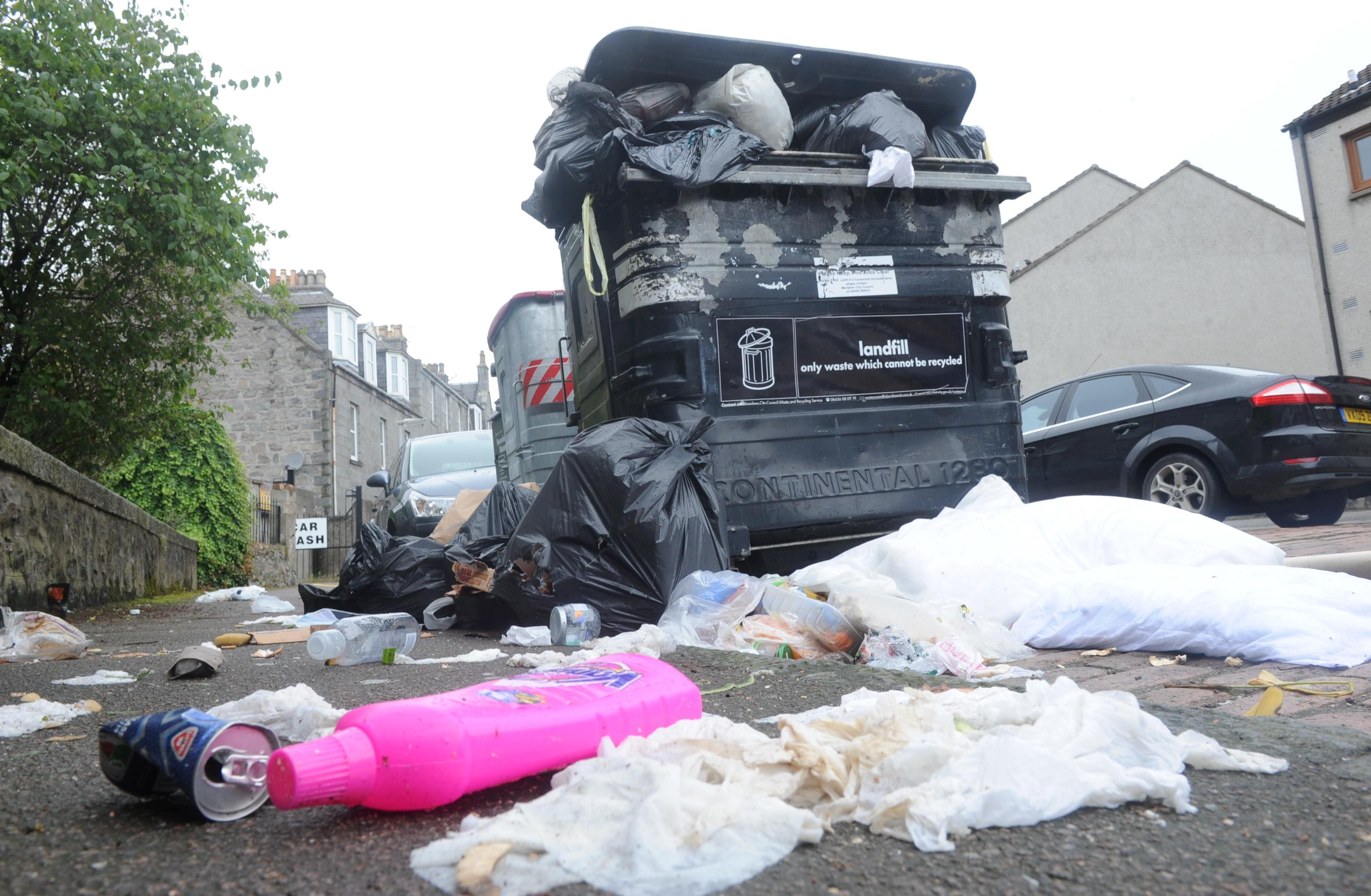 Bins  were left overflowing on the city's Jute Street.