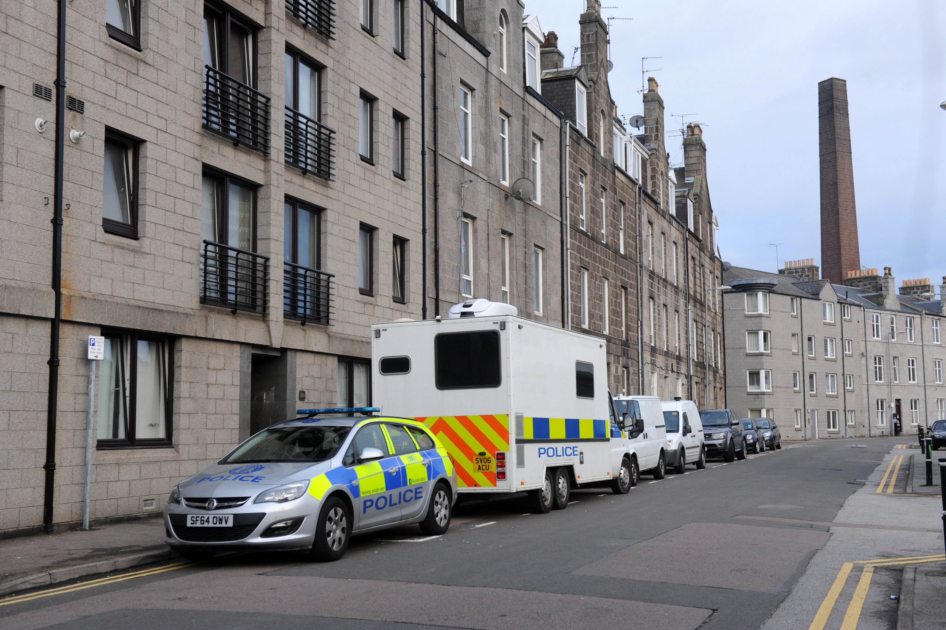 Police maintained a presence on Holland Street as the investigation continued.  Picture by Kath Flannery