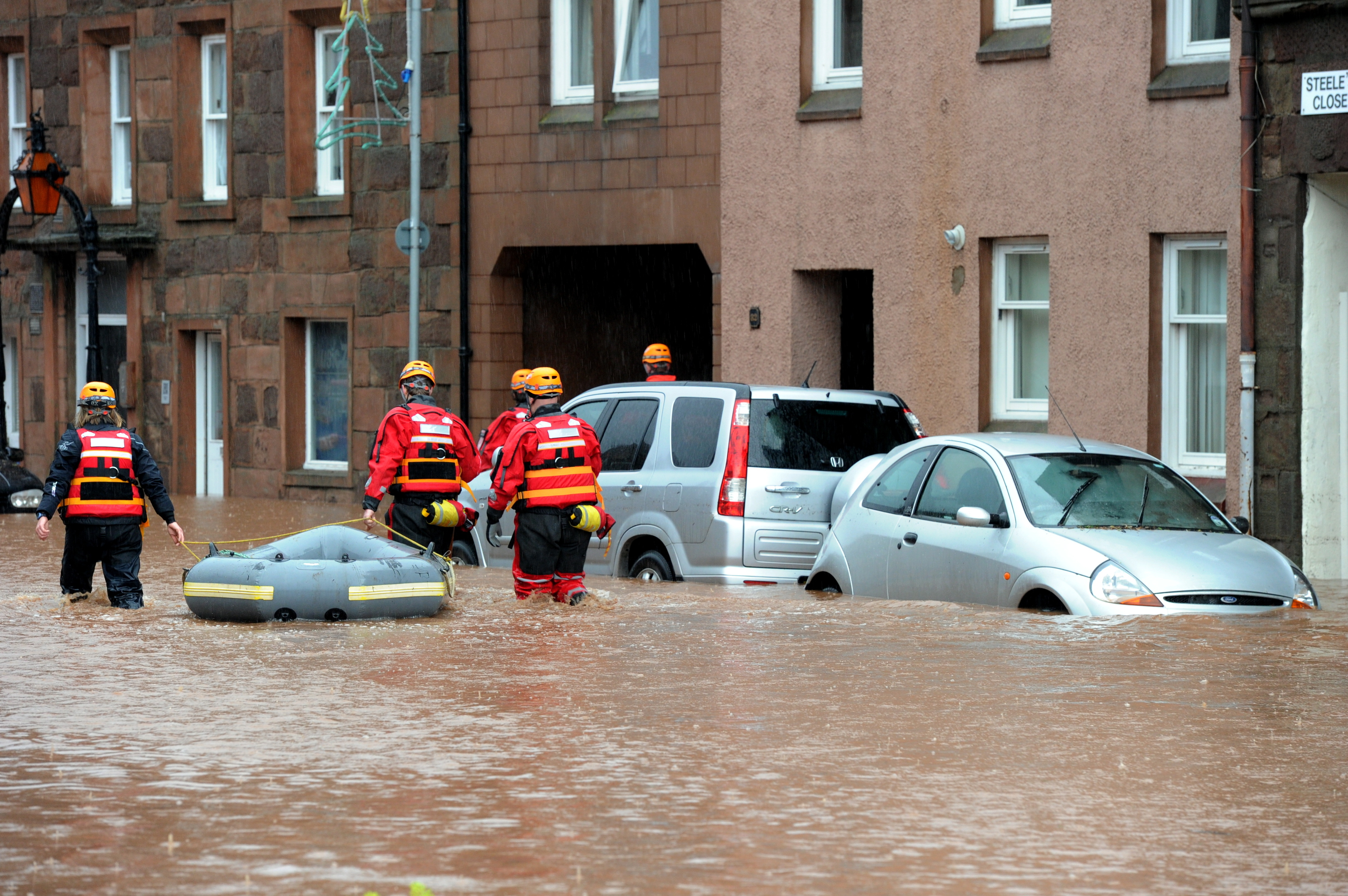 A rescue crew at work in Stonehaven's High Street after flood waters hit the town causing damage in December 2012.