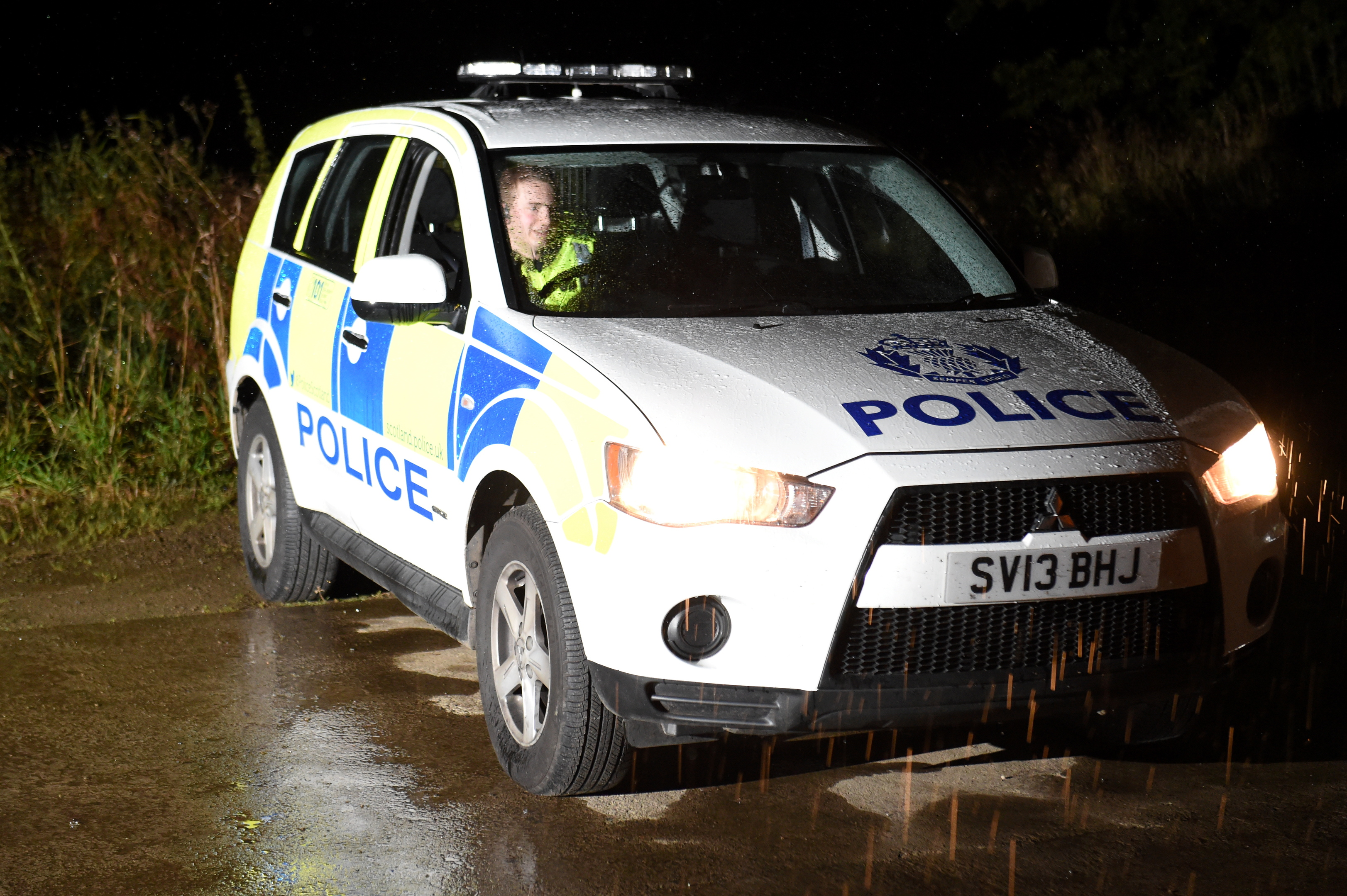 Police Scotland officers at the scene in New Deer.