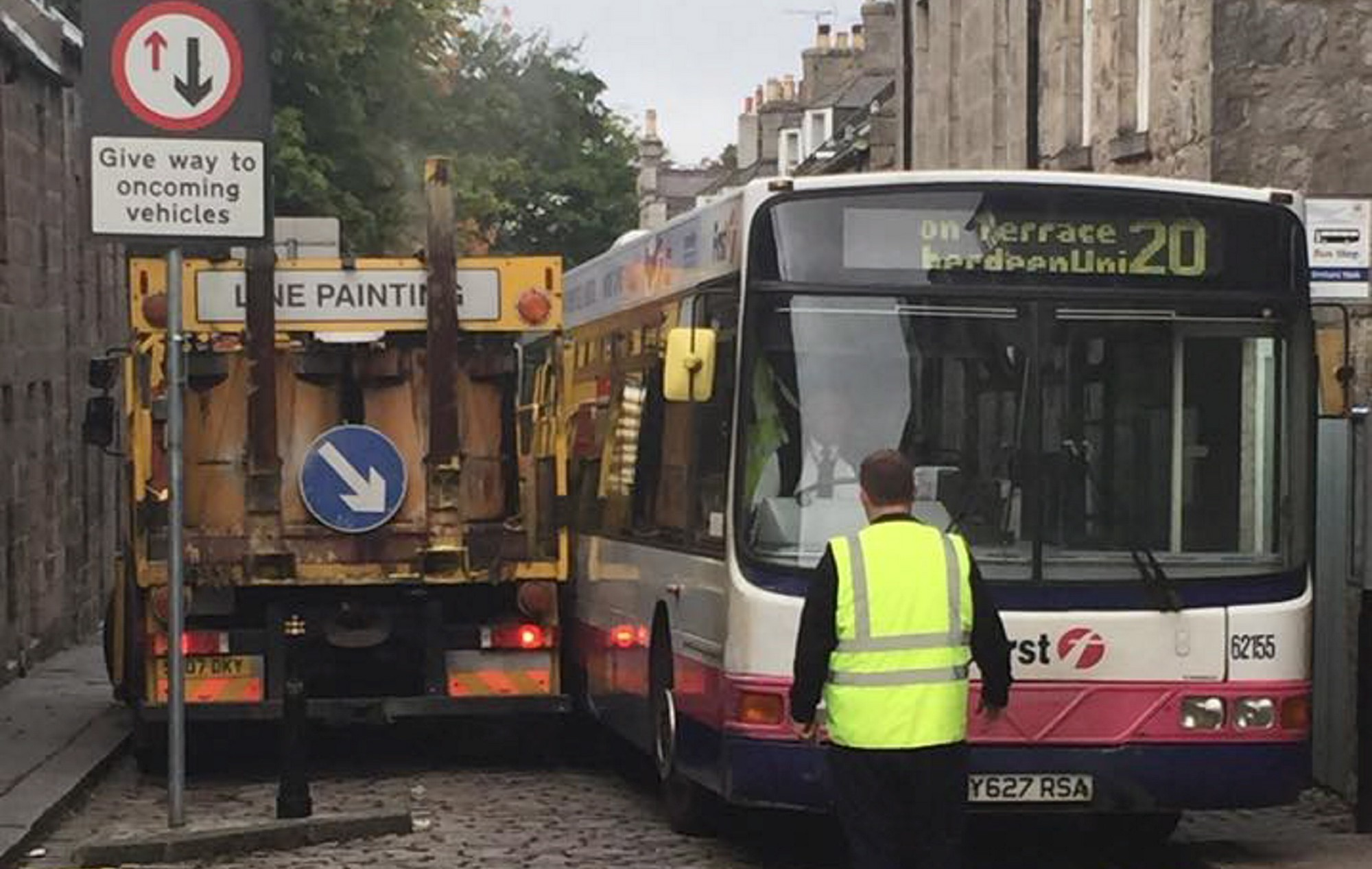 The bus got stuck alongside a council lorry on College Bounds. Picture by reader Stuart Stephen Jnr