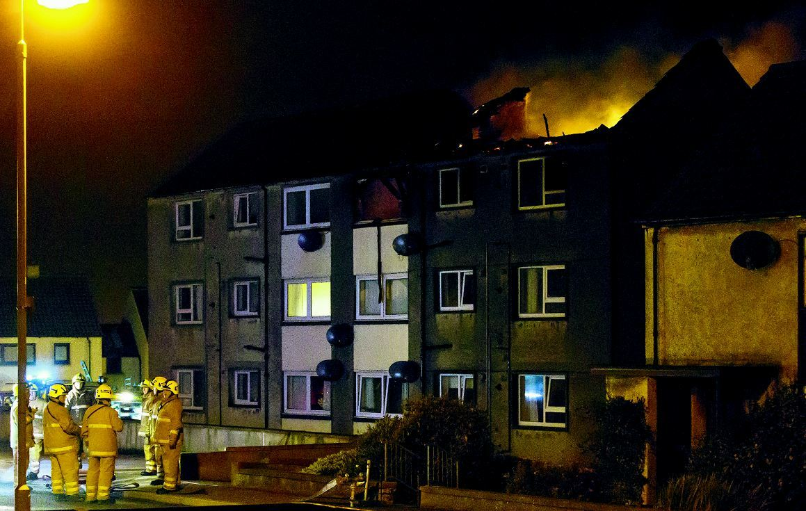 Firefighters at the scene of the flat fire in Macduff.