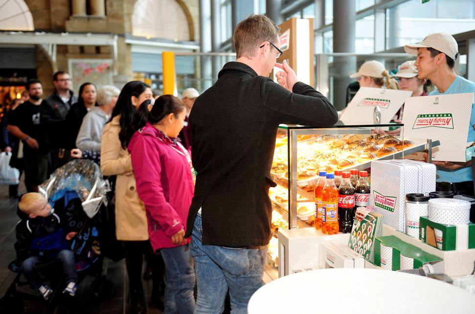 Hungry shoppers stood in line as Krispy Kreme opened in Union Square.