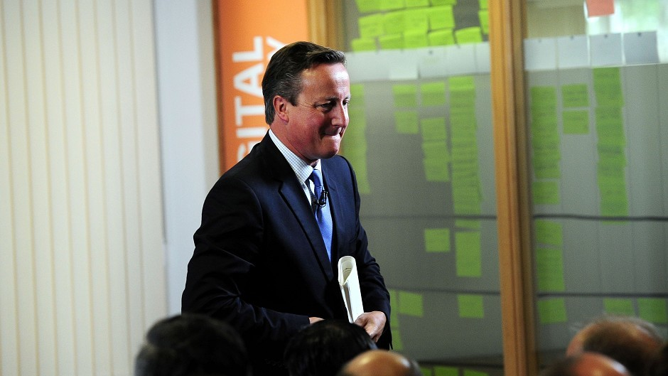 Prime Minister David Cameron leaves the stage after making a speech in Leeds