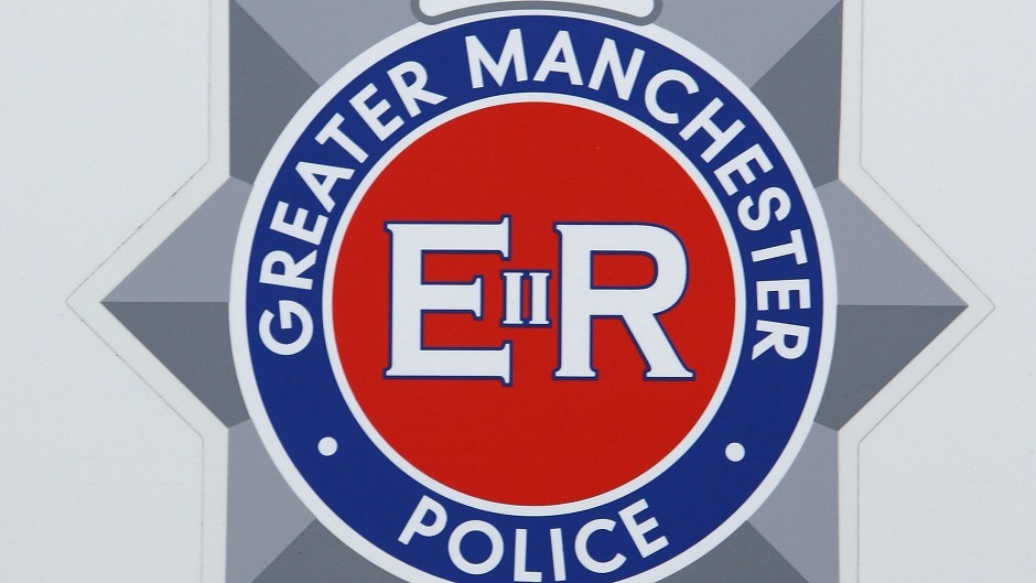 Police in Manchester are appealing for information after a mother and her son, aged 7, was shot on their own doorstep.