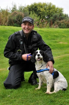 PC Steve Warden, Regional Police Dog Instructor, with his spaniel Patch.
