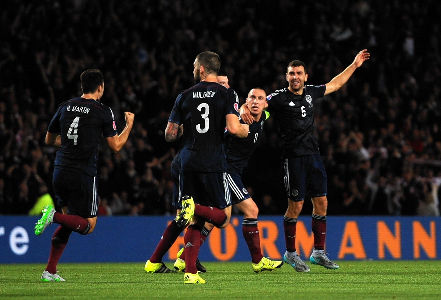 Scotland celebrating James McArthur's goal.