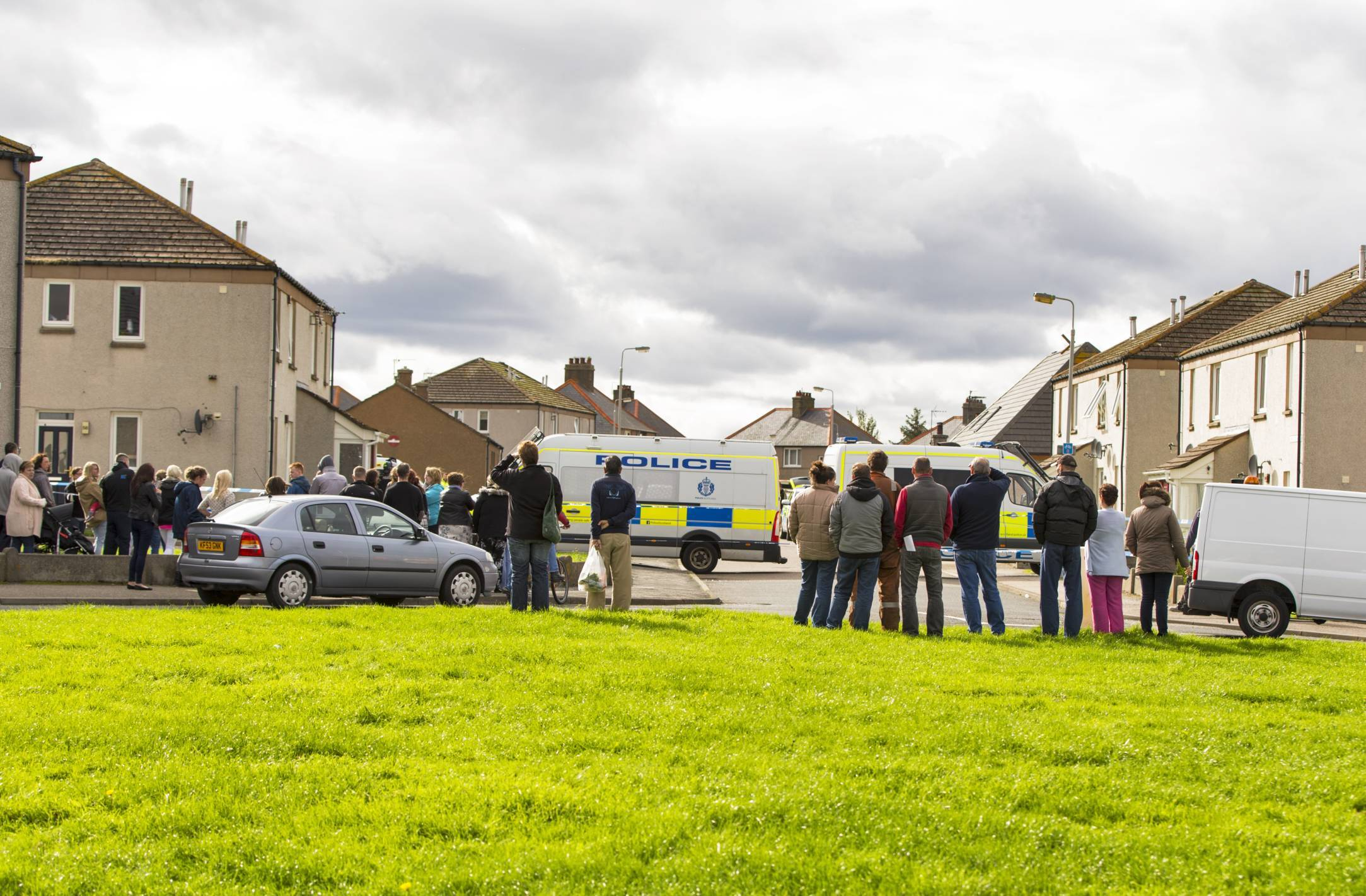 Residents watch as police deal with the incident in the Wallace Avenue area of Buckie.
