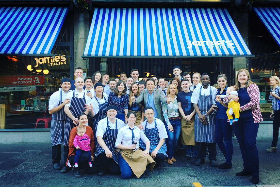 Jamie Oliver poses with staff outside his restaurant on Aberdeen's Union Street.  Picture from Jamie Oliver (via Instagram)