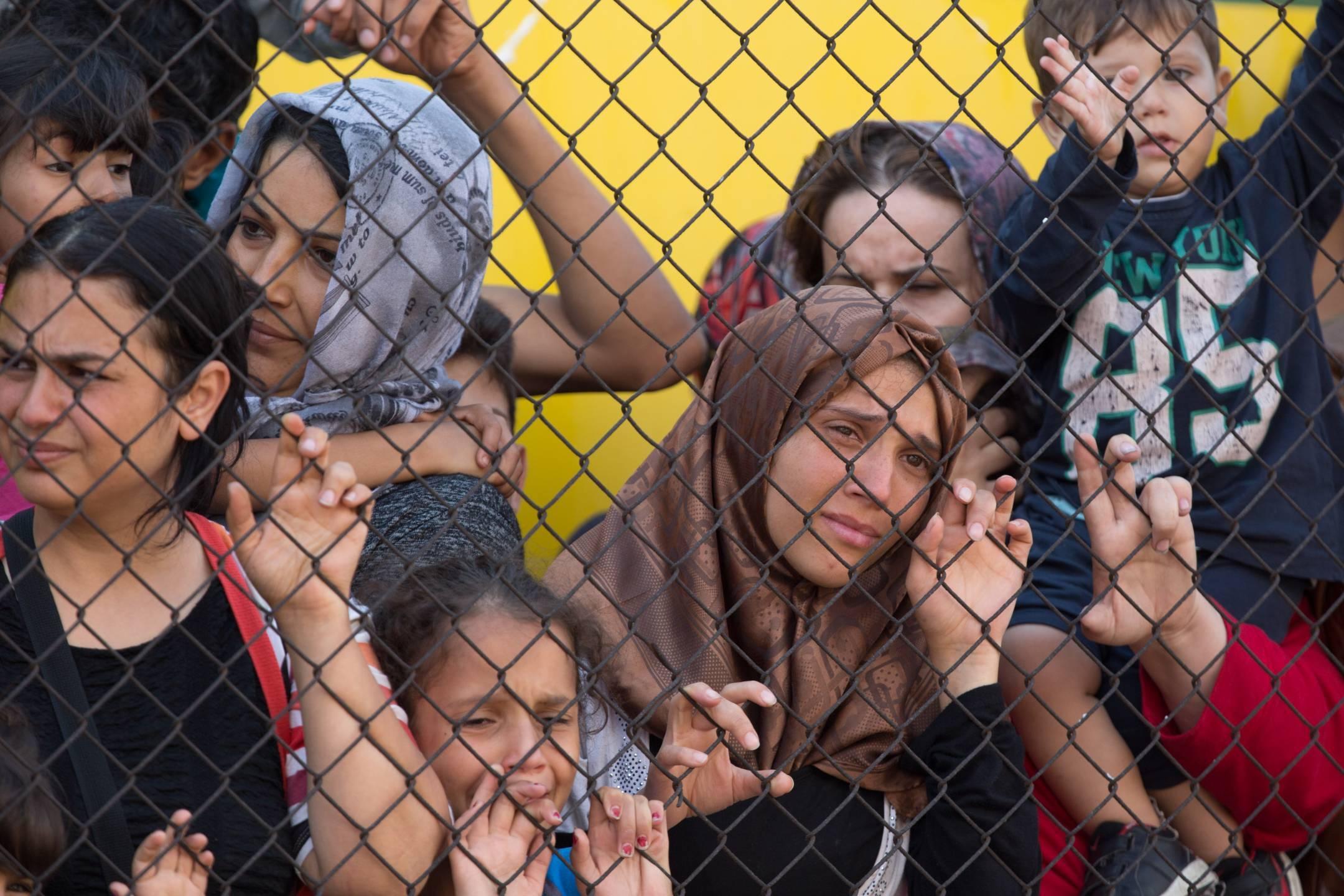 Migrants protest outside a train at Bicske station, near Budapest