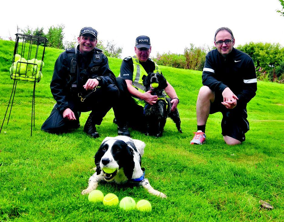 Pictured from left are PC Steve Warden, Regional Police Dog Instructor with his spaniel Patch,Sergeant Bob Saunders with his dog Peppi and Kirk Hemmings, David Lloyd member and PC at Aberdeen control room.