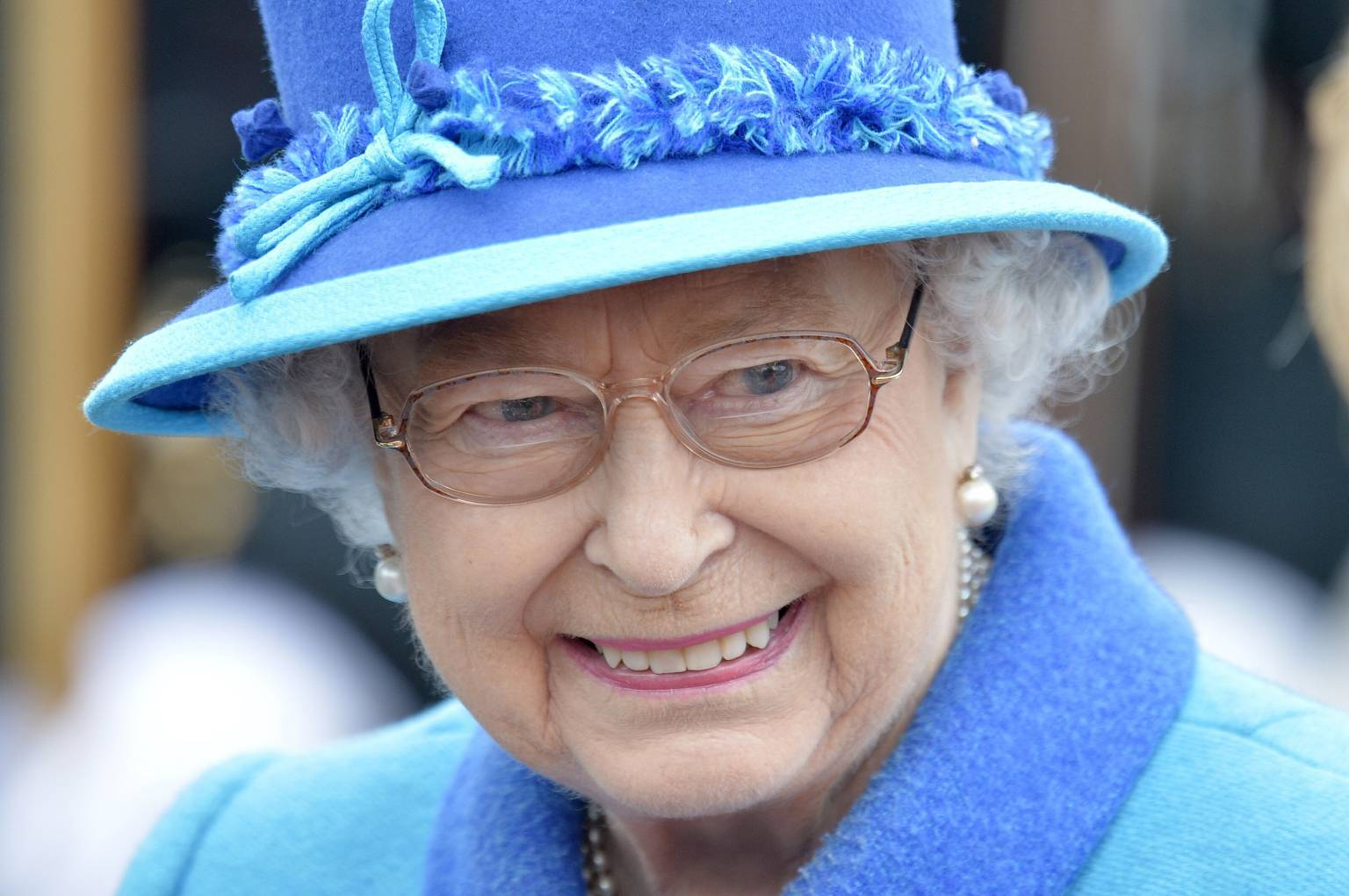 Queen Elizabeth II smiles as she arrives at Tweedbank, on the day she becomes Britain's longest reigning monarch.
