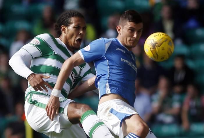 Celtic's Virgil Van Dijk and St Johnstone's Graham Cummins battle for the ball.