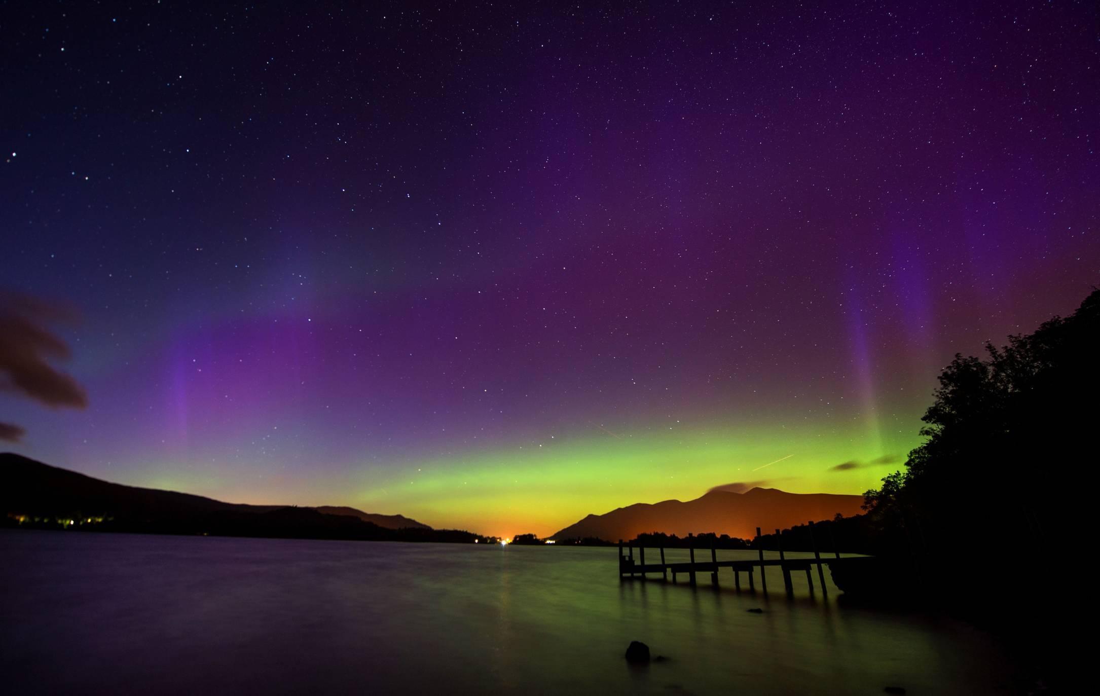 The Northern Lights, or Aurora Borealis, shine over Derwentwater.