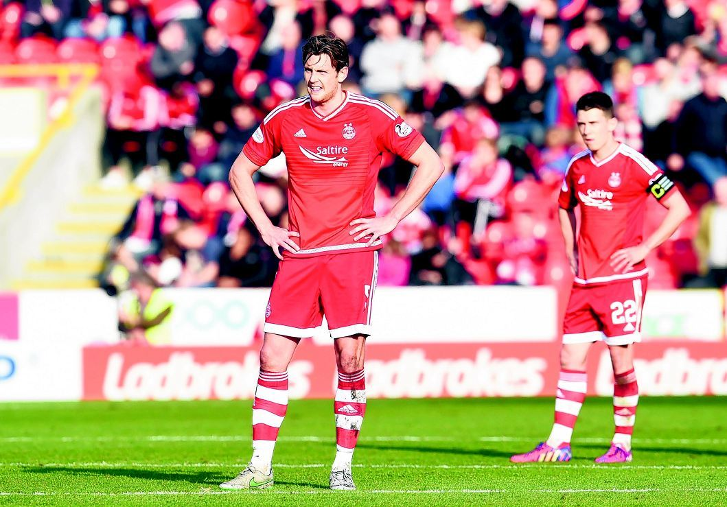 Ash Taylor and Ryan Jack find defeat hard to take at Pittodrie.