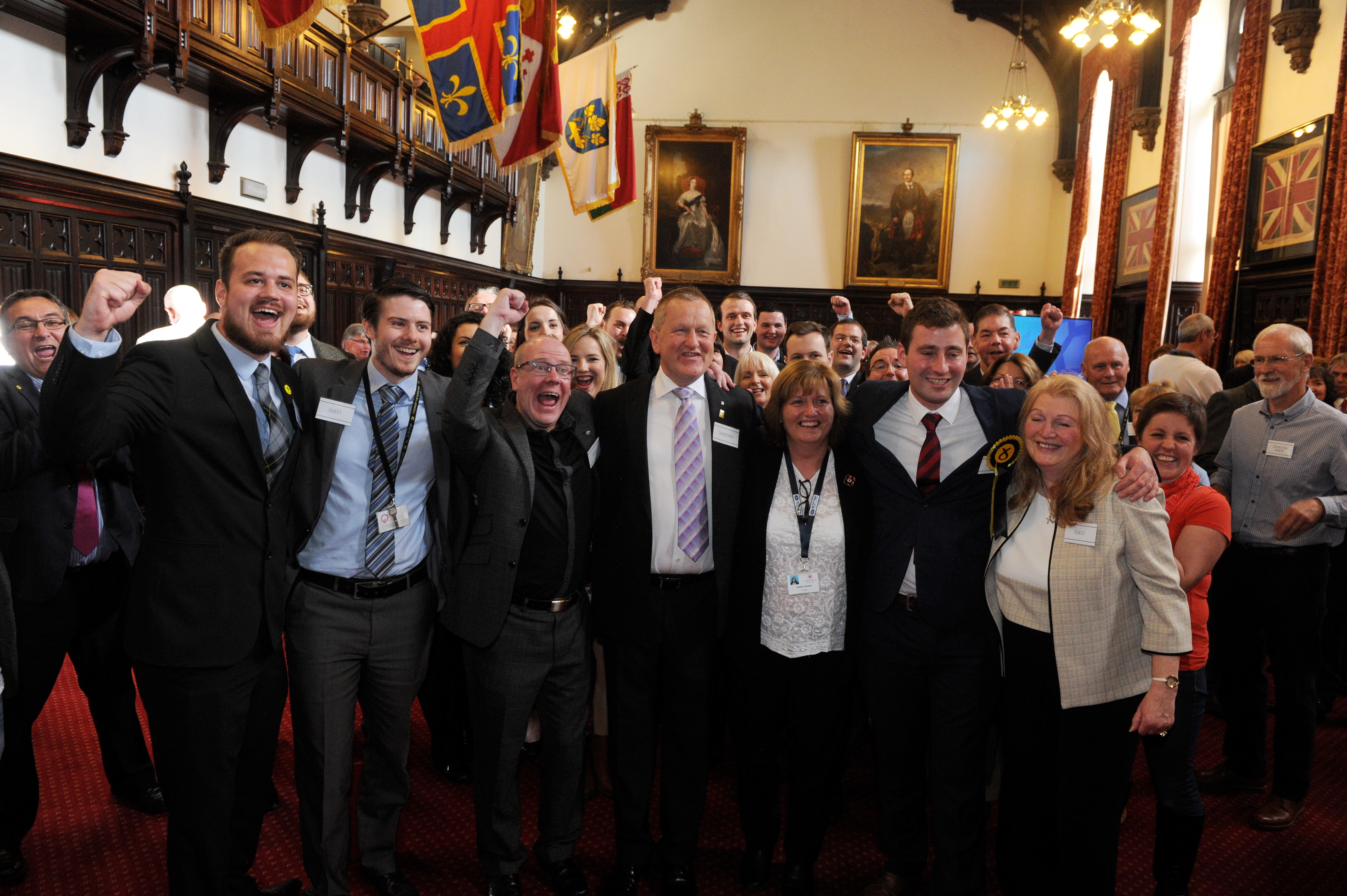 Newly elected councillors Michael Hutchison and Alex Nicoll celebrate their by-election success with fellow SNP members.