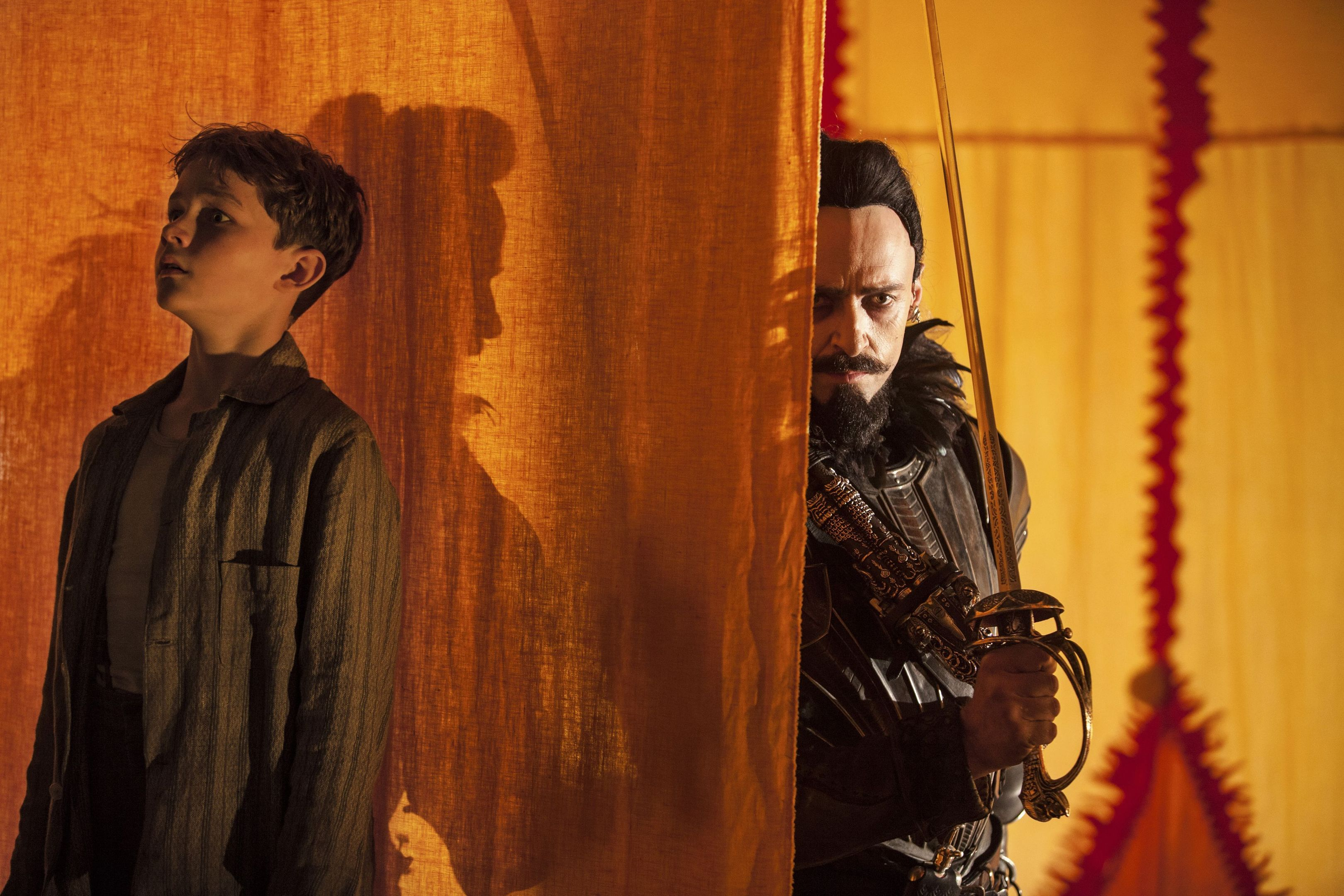 Peter Pan (Levi Miller) hides from Blackbeard (Hugh Jackman)  in a scene from Pan.