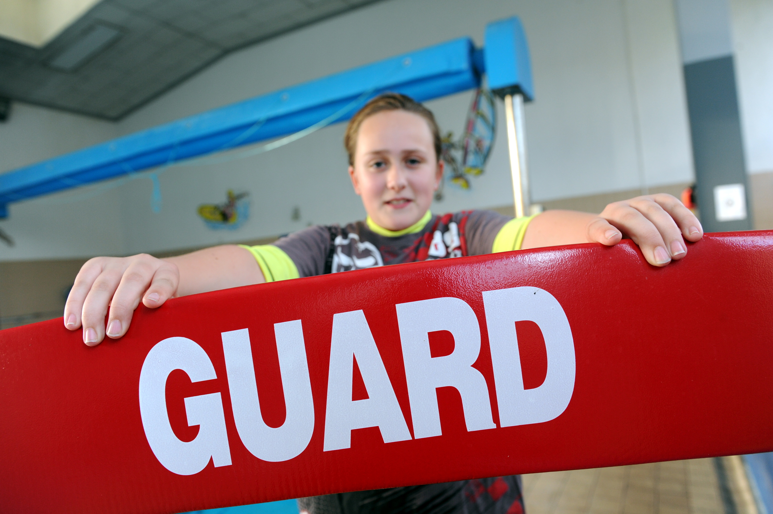 Becky, a rookie lifeguard, has been swimming since she was seven and is working towards her gold level.