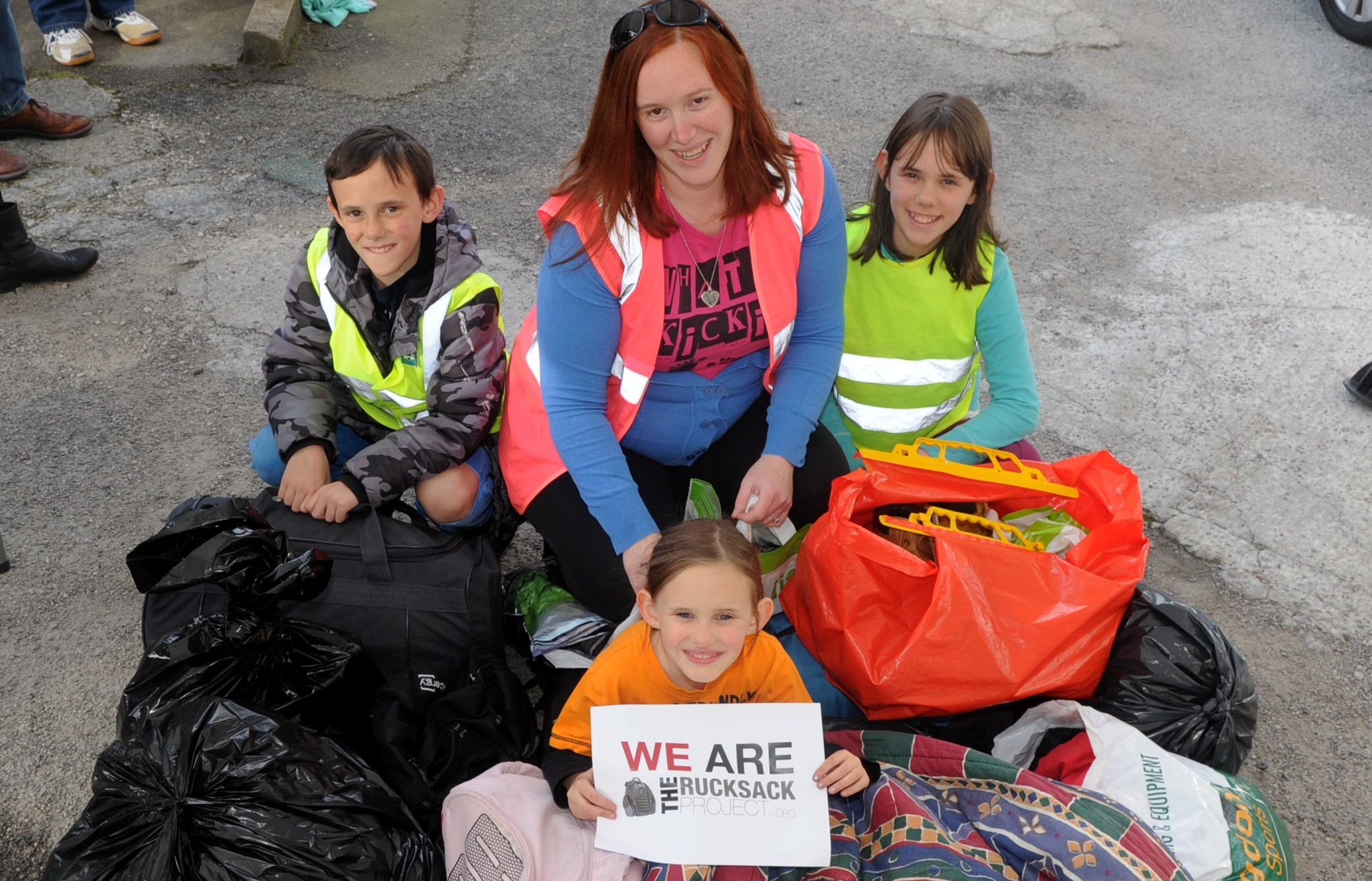 Amber Sebold, centre, held a rucksack collection for the homeless with her children, clockwise from left, Calvin, Cora and Maia.