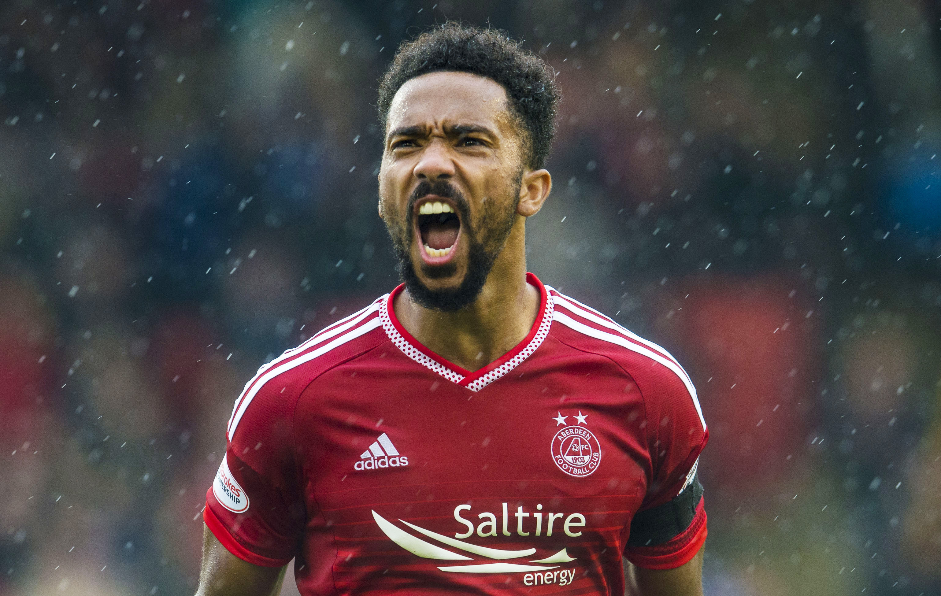 Dons defender Shay Logan has signed a new deal.