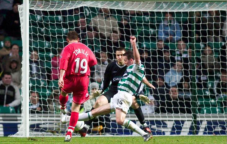 David Zdrilic  evades a last-ditch tackle from Paul Lambert to score a historic winner for Aberdeen.