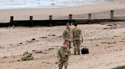 Specialist's from bomb squad prepare the site