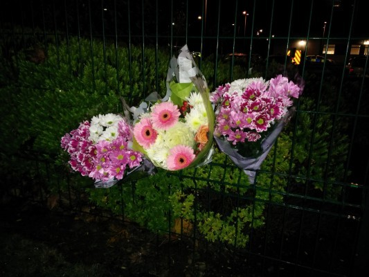 Pupils have left floral tributes to their dead friend.