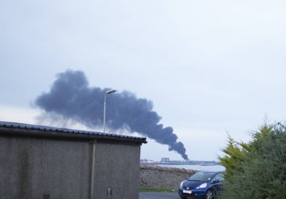 Smoke from the fire at Peterhead harbour could be seen from miles around. Picture by  Jay Buchan (Owl Berry photography)