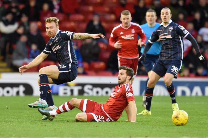 Ross County's Craig Curran (left) is tackled by Graeme Shinnie