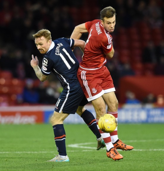 Ross County's Craig Curran (left) battles with Andrew Considine