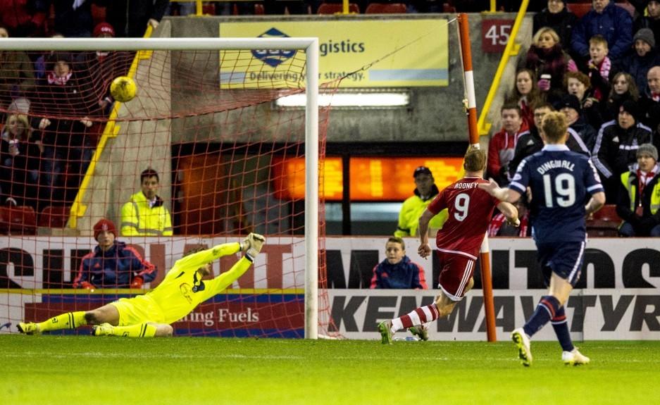 Aberdeen striker Adam Rooney (9) scores his side's equalising goal