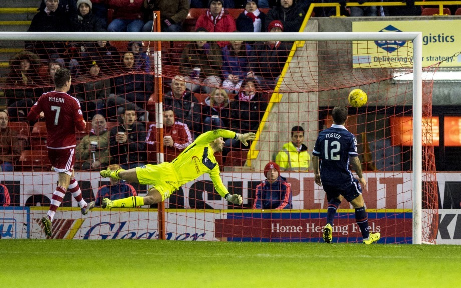 Ross County's Gary Woods (centre) fails to keep out Aberdeen's Jonny Hayes cross