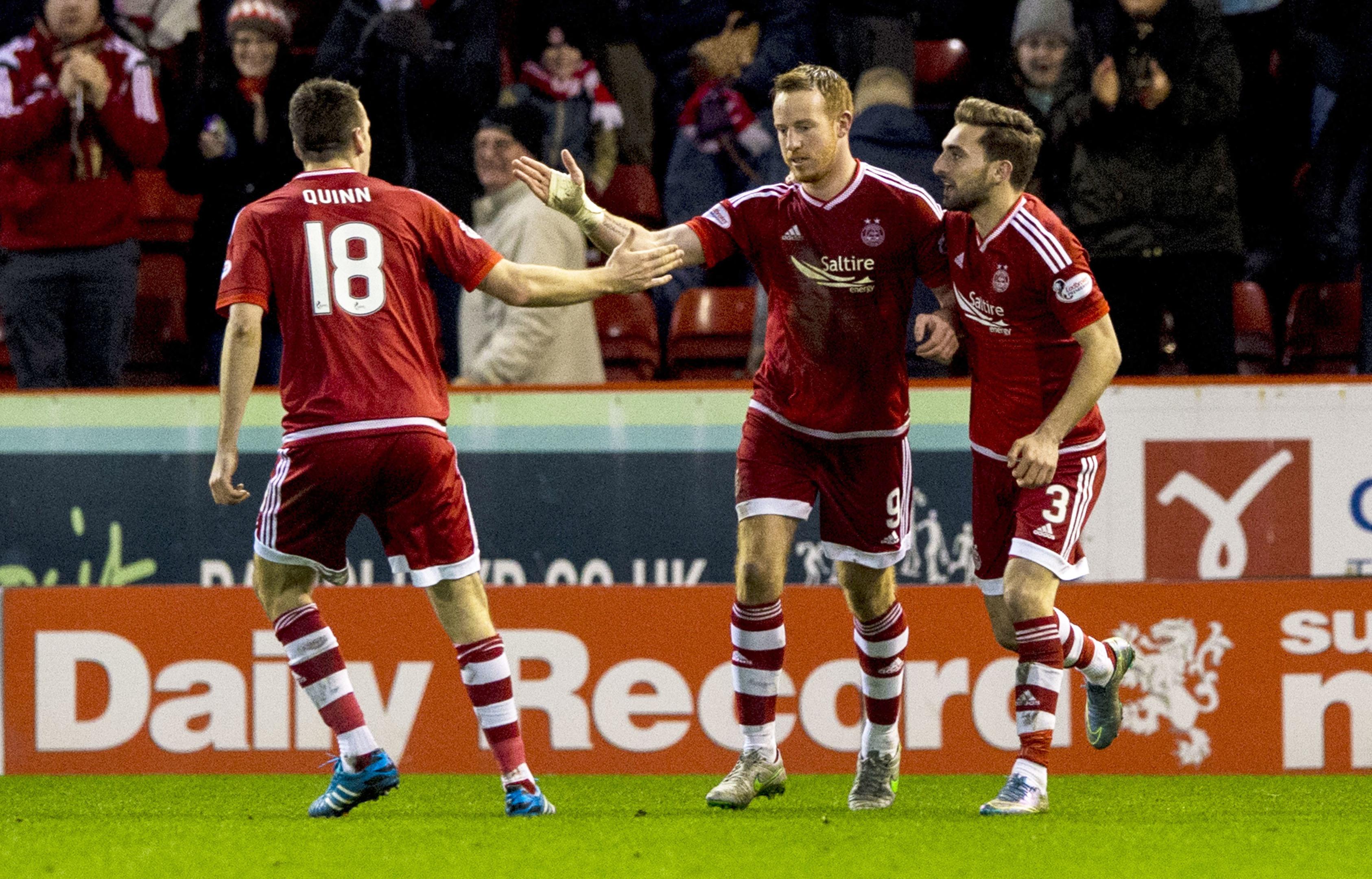 Aberdeen striker Adam Rooney (centre) celebrates his goal with team-mates Graeme Shinnie (right) and Paul Quinn