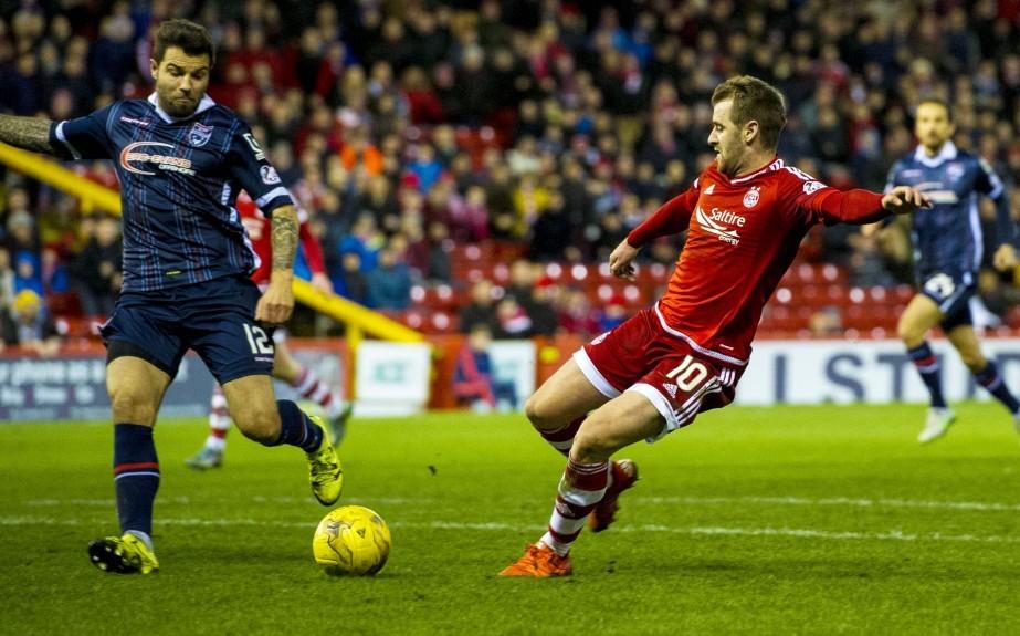 Aberdeen's Niall McGinn (right) scores his side's third goal