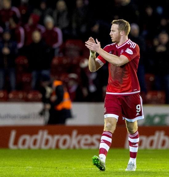 Aberdeen striker Adam Rooney applauds the fans at full-time