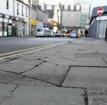 A damaged pavement on Chapel Street in the city centre.