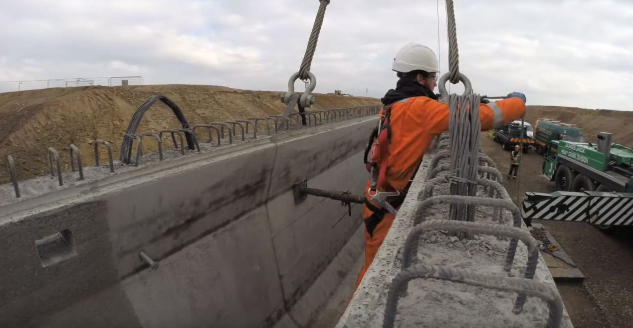 The video shows construction of the new overpass on the A90.
